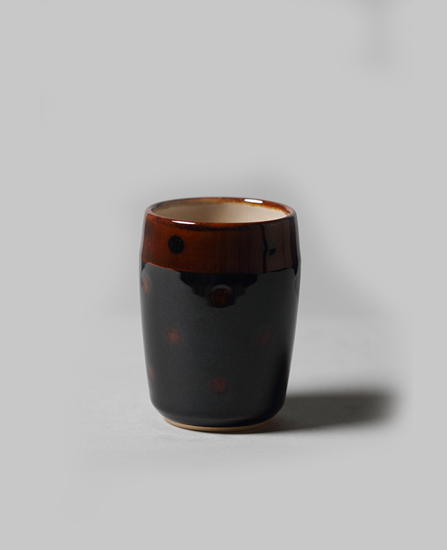black and amber ohi tea cup